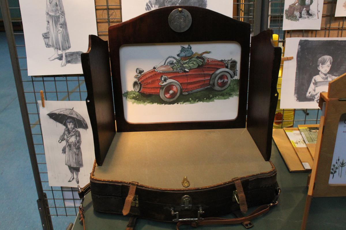 Peinture de rat conduisant une voiture