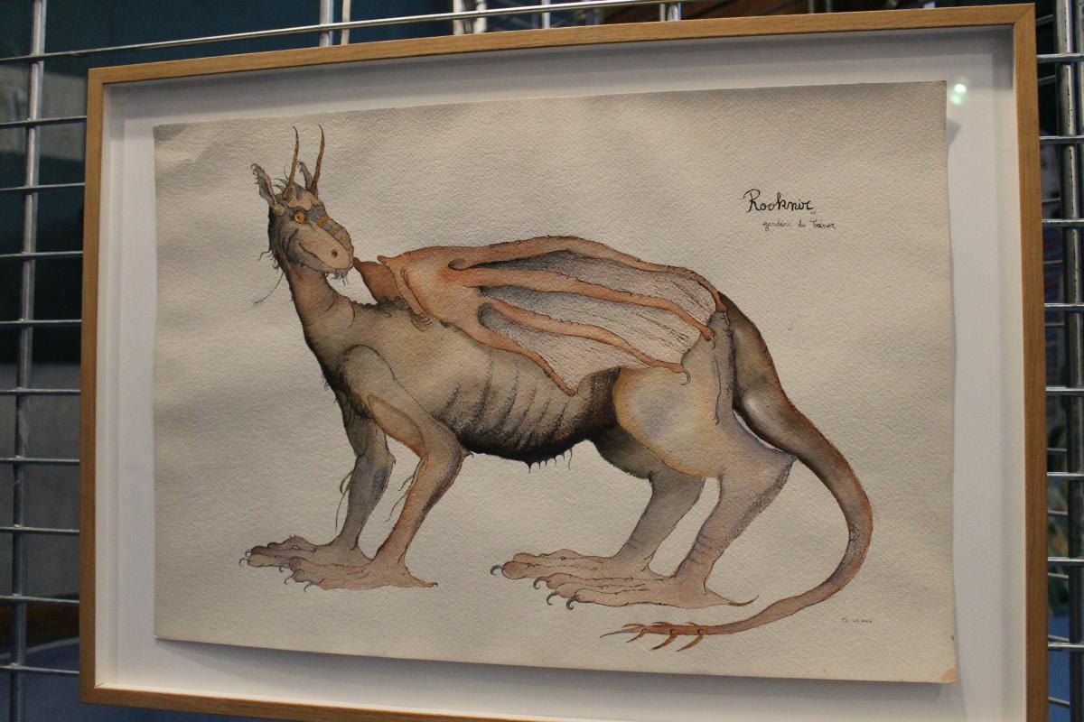 Peinture de dragon accrochée au mur